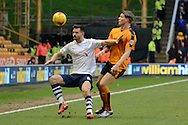 Preston North End defender Bailey Wright holds off Wolverhampton Wanderers striker Bjorn Sigurdarson during the Sky Bet Championship match between Wolverhampton Wanderers and Preston North End at Molineux, Wolverhampton, England on 13 February 2016. Photo by Alan Franklin.