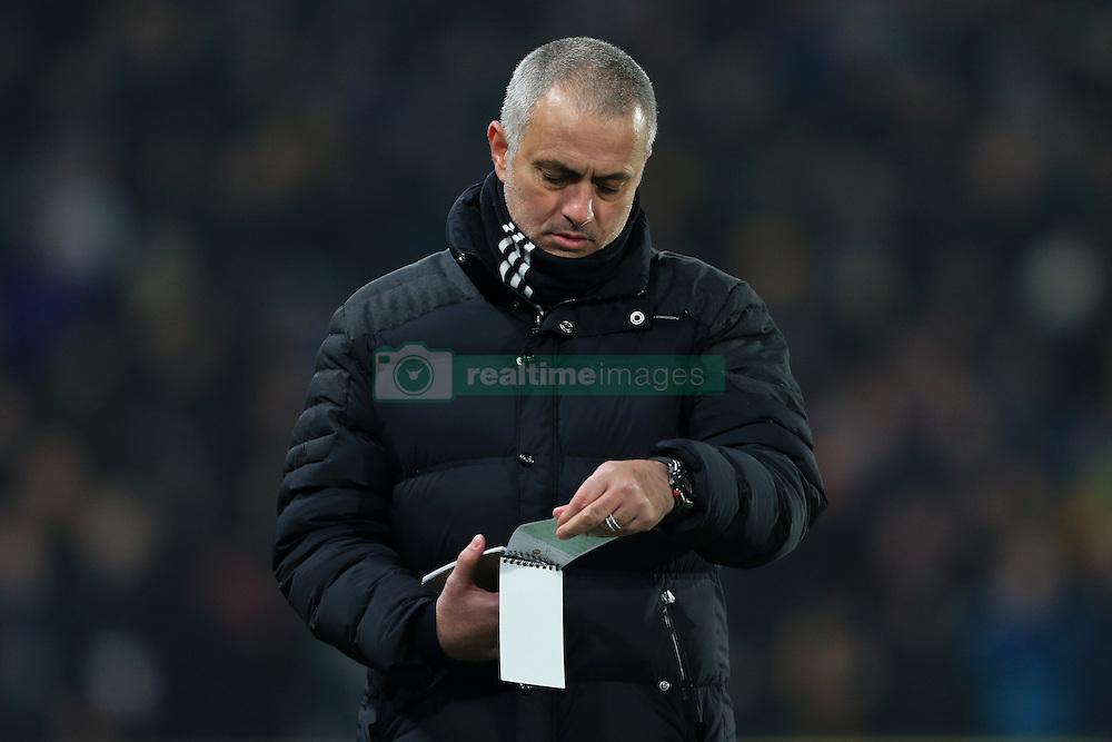 26th January 2017 - EFL Cup (Semi-Final) - Hull City v Manchester United - Man Utd manager Jose Mourinho checks his notepad - Photo: Simon Stacpoole / Offside.