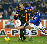 Photo: Dave Linney.<br />Leicester City v Wolverhampton Wanderers. Coca Cola Championship. 04/02/2006.Wolves Kenny Miller(L) fends off the challenge from  James Wesolowski