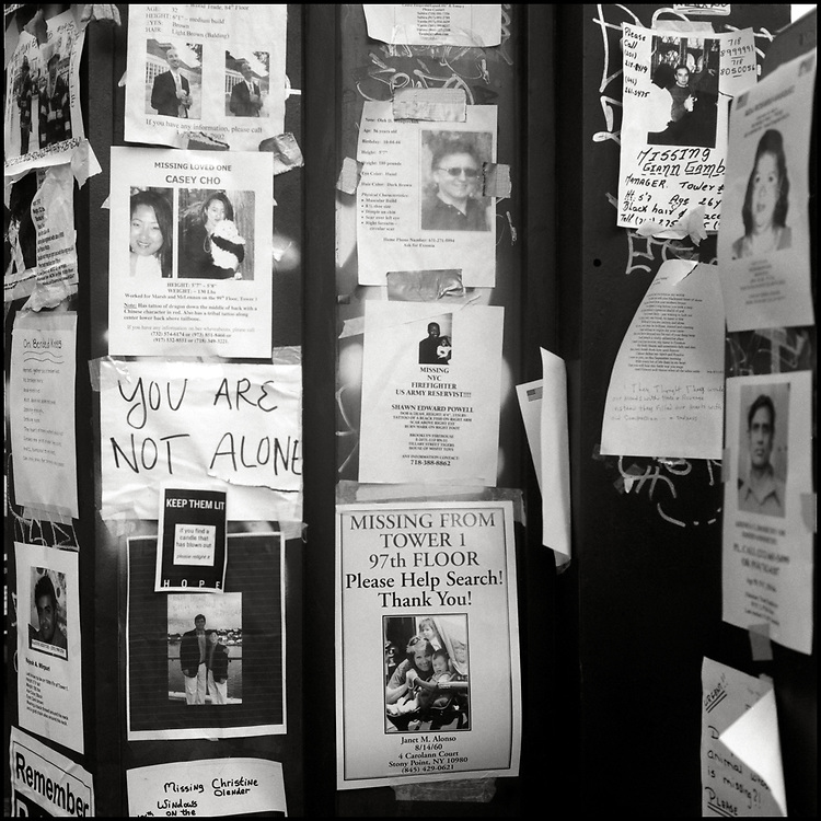 """In the days following the terrorist attack on The World Trade Center, """"Missing"""" signs began popping up all over New York City, creating a city wide memorial."""