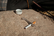 WARNING GRAPHIC CONTENT: A needle filled with heroin sits on a rock along the dry riverbed of the Rio Grande River in Juarez, Mexico January 16, 2009 as junkies prepare to shoot up along  the US border. An ongoing drug war between cartels for control of the drug routes into the US killed 1600 people in Juarez last year and already 40 since the start of the new year making the city the most violent in Mexico.   (Photo by Richard Ellis)