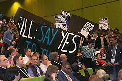 © Licensed to London News Pictures. 23/07/2014. Protestors interrupt former US President Bill Clinton speech during a session of the 20th International AIDS conference held in Melbourne Australia. Photo credit : Asanka Brendon Ratnayake/LNP