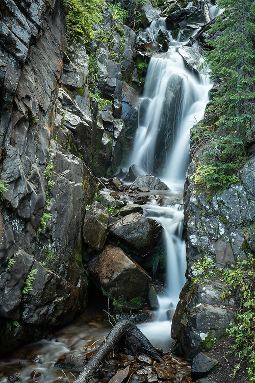 Venable Falls tumbles through a tight, rock-walled canyon about 2 miles uphill from the Rainbow Trail.