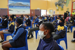 South Africa - Cape Town - 19 October 2020 -  Learners wearing facemasks listen to Minister Naledi Pandor at Klapmuts Primary School. The Minister of International Relations and Cooperation, Dr Naledi Pandor, who also serves on the National Coronavirus Command Council (NCCC), handed over a consignment of Personal Protective Equipment (PPEs) to schools in the Stellenbosch region, Western Cape Province. The PPEs will be used for the benefit of learners, educators and administrators. Minister Pandor also offered messages of support to the schools and conveyed the government's approach in the fight against COVID-19.  Picture Henk Kruger/African News Agency (ANA)