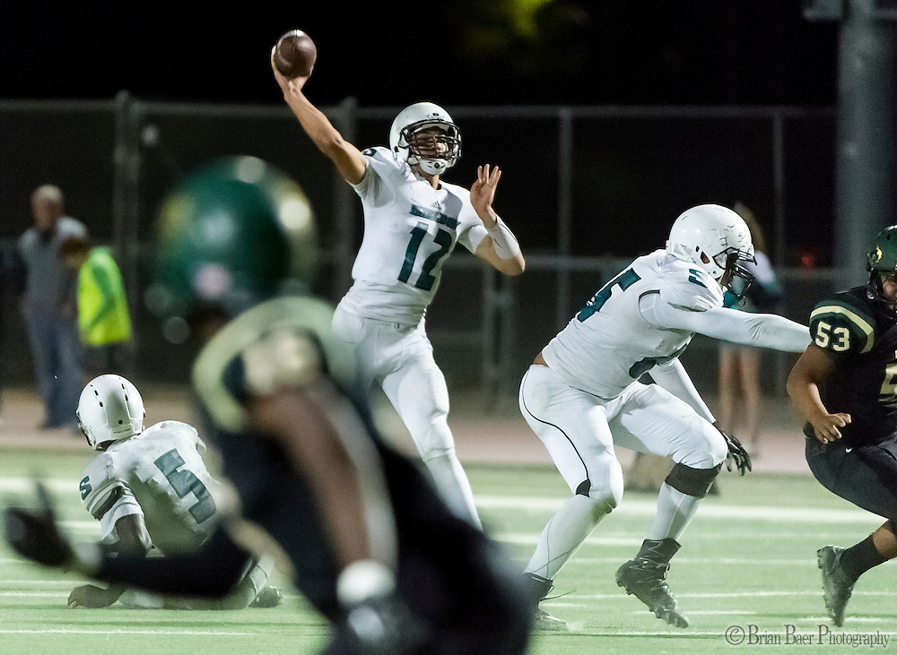 Sheldon High School Husky Chancellor Lachapelle (12), passes the ball during the third quarter as the Monterey Trail Mustangs host the Sheldon High School Huskies Friday Sep 23, 2016. Sheldon won the game 27-22.<br /> photo by Brian Baer