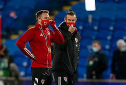 CARDIFF, WALES - Wednesday, November 18, 2020: Wales' Chris Gunter (L) and captain Gareth Bale on the pitch before the UEFA Nations League Group Stage League B Group 4 match between Wales and Finland at the Cardiff City Stadium. Wales won 3-1 and finished top of Group 4, winning promotion to League A. (Pic by David Rawcliffe/Propaganda)