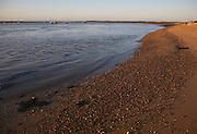 Low tide beach dusk in winter, Bawdsey Quay, Suffolk, England