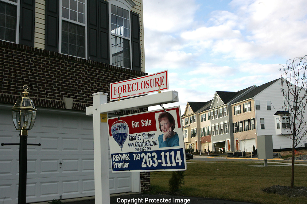 A house for sale in a foreclosure status in Woodbridge, Virginia. Photograph by Dennis Brack