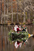 Santa Claus arrives by swamp boat at Cypress Gardens Swamp December 1, 2012 in Moncks Corner, SC. The public park holds 80 acres of blackwater bald cypress and tupelo swamp outside Charleston.