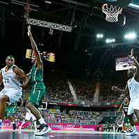 06 August 2012: France Boris Diaw drives past Nigeria Al-Farouq Aminu as Ali Traore calls for the ball during 79-73 Team France victory over Team Nigeria, during the men's basketball preliminary, at the Basketball Arena, in London, Great Britain.