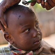 Little Djibi is prepared for Muslim New Year. Koumbadiouma in Kolda, Senegal.