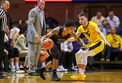 Mar 20, 2019; Morgantown, WV, USA; Grand Canyon Antelopes guard Damari Milstead (11) dribbles while guarded by West Virginia Mountaineers guard Jordan McCabe (5) during the second half at WVU Coliseum. Mandatory Credit: Ben Queen