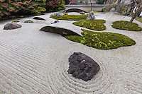 Jisso-in -  The stone garden of Jisso-in has a number of modern features that make it unique among this collection of Zen gardens. Containing the customary pebbles of similar gardens, the Jisso-in garden contains large moon shaped stones that appear as though they are submerged below the gravel and moss surface. Looking like giant ocean waves, these man-made stones rise up alongside the garden's mossy island and formed stones. The garden has a surrounding wall that is lined with trees, and its unusual elements contribute to the garden's compelling elegance.