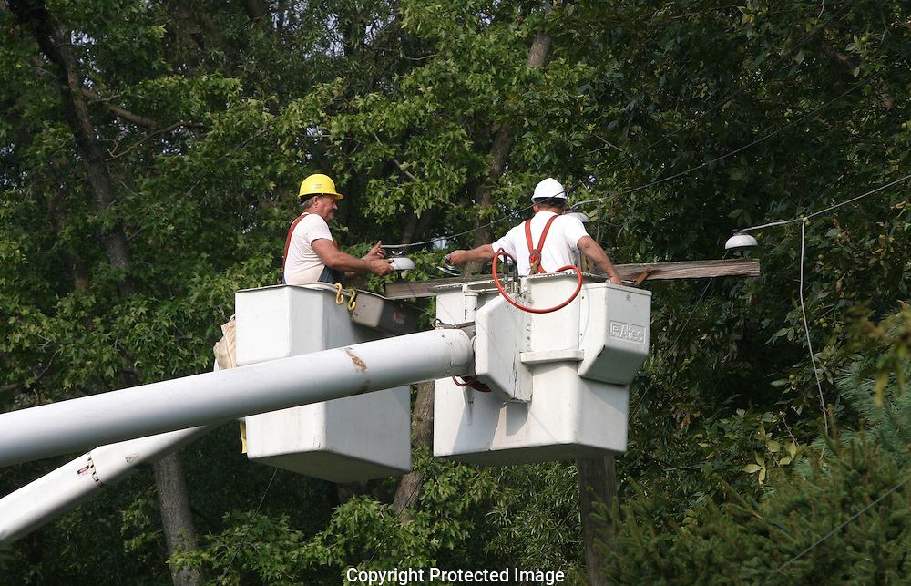 A 18 MG IMAGE OF:..A power company linemen repair  electrical power line after Hurricane Isabel