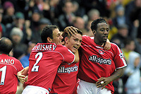 Matt Holland (Charlton) celebrates his goal with Radostin Kishishev and Jason Euell (right). Charlton Athletic v Chelsea. 26/12/2003. Credit : Colorsport/Andrew Cowie.
