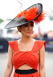 A racegoer arrives during Ladies Day of the 2019 Invested Derby Festival at Epsom Racecourse, Epsom.