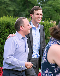 White House Chief of Staff Reince Priebus, left and Senior Advisor Jared Kushner are all smiles at the annual Congressional Picnic on the South Lawn of the White House in Washington, DC, USA, on Thursday, June 22, 2017. Photo by Ron Sachs/CNP/ABACAPRESS.COM