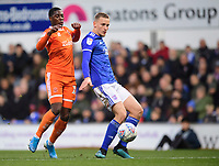 Ipswich Town's Luke Woolfenden shields the ball from Blackpool's Sullay Kaikai<br /> <br /> Photographer Chris Vaughan/CameraSport<br /> <br /> The EFL Sky Bet League One - Ipswich Town v Blackpool - Saturday 23rd November 2019 - Portman Road - Ipswich<br /> <br /> World Copyright © 2019 CameraSport. All rights reserved. 43 Linden Ave. Countesthorpe. Leicester. England. LE8 5PG - Tel: +44 (0) 116 277 4147 - admin@camerasport.com - www.camerasport.com