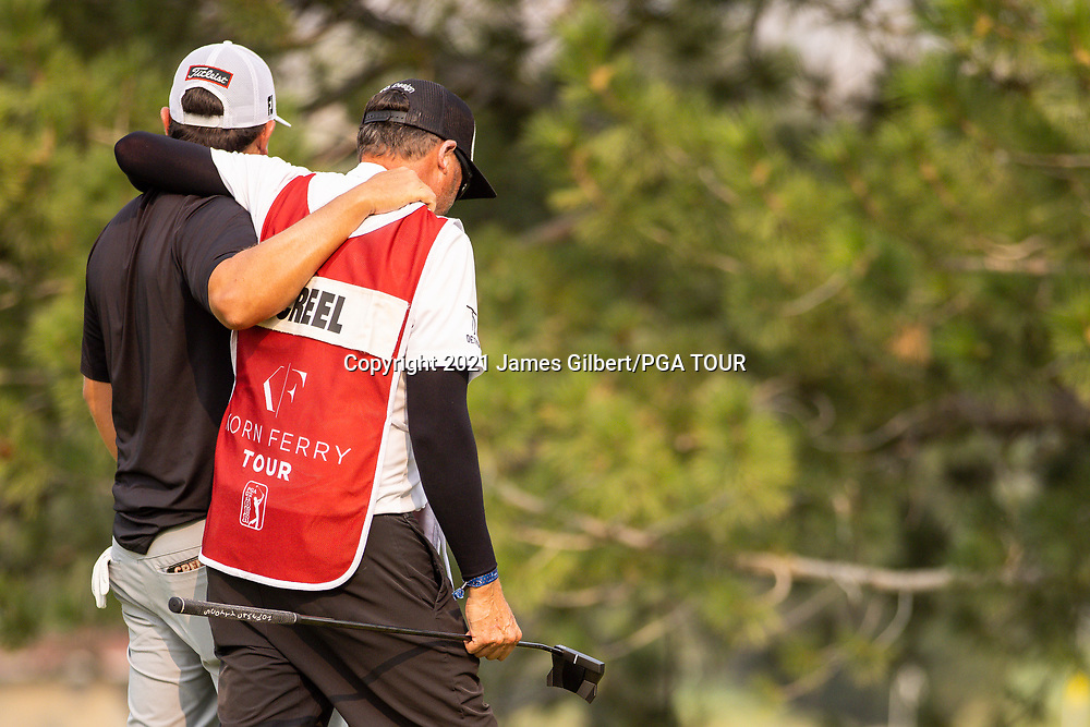 FARMINGTON, UT - AUGUST 08: Joshua Creel celebrates with his caddie Tim after sinking his putt on the 18th green to win the final round of the Utah Championship presented by Zions Bank at Oakridge Country Club on August 8, 2021 in Farmington, Utah. (Photo by James Gilbert/PGA TOUR via Getty Images)