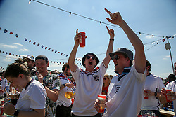 © Licensed to London News Pictures. 13/06/2021. London, UK. Fans react during the England v Croatia game on the big screen at Skylight Rooftop, Tobacco Dock in London. Photo credit: Dinendra Haria/LNP