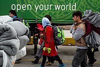 ATHENS, GREECE - FEBRUARY 04: Refugees walk toward the buses that will take them to the Macedonian border after disembarking a ferry at the Pireaus port from the Greek islands on February 04, 2015 in Athens, Greece. Thousands of refugees arrive every day by ferries fleet by private companies from the Greek islands to the Pireaus port. Photo: © Omar Havana. All Rights Are Reserved