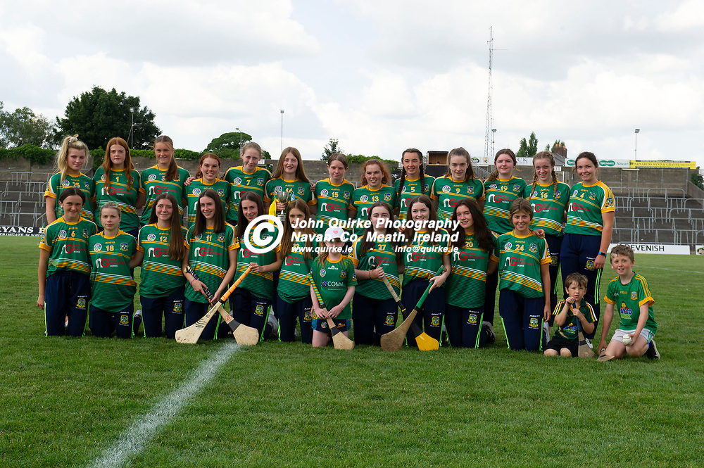 25-07-21. Meath v Dublin All-Ireland Intermediate Camogie Championship (Group 1) at Pairc Tailteann, Navan.<br />The Meath U-16 All-Ireland B winning team who were introduced at half time L to R.<br />Back: Holly Macken, Amy Lawless, Gracie Grehan, Sarah Brien, Roisin Heaney, Laura Kelly (Capt), Ella O'Brien, Michelle Brien, Lily Dwyer,  Aoife Carey, Izzy Kinsella, Maddy McKinley, Alannah Brady.<br />Front: Kerrie Cole, Brooke Flynn, Anna Foley, Katie Connolly (Vice Capt), Grace Connolly, Emma O'Neill, Caoimhe Heaney (Mascot), Alannah Rattigan, Sarah Pierse, Saoirse Delaney and Amy Shankey. (Mascots: Seanie O'Brien and Jamie O'Brien). Not present, Jorja Keogh, Katie Mulchrone, Clara Leddy, Lily Jane Smith and Lara Lacey.<br />Photo: John Quirke / www.quirke.ie<br />©John Quirke Photography, 16 Proudstown Road, Navan. Co. Meath. (info@quirke.ie / 046-9028461 / 087-2579454).