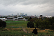 The view of Canary Wharf on a cloudy day, taken from Greenwich Park, just by the Observatory.