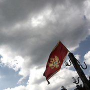 """Montenegro flag  <br /> There are several arguments about the derivation of the name  """"Montenegro"""", one of these relates to dark and deep forests  that once covered the Dinaric Alps, as it was possible to see them from the sea. <br /> Mostly mountainous with 672180 habitants on an area of 13812 Km², with a population density of  48 habitants/Km². <br /> It borders with Bosnia, Serbia, Croatia, Kosovo and Albania but  Montenegro has always been alien to the bloody political events that characterized Eastern Europe in recent decades. <br /> From 3 June 2006, breaking away from Serbia, Montenegro became an independent state. <br /> In the balance between economy devoted to sheep farming and a shy tourist, mostly coming from Bosnia and Herzegovina, Montenegro looks to Europe with a largely unspoiled natural beauty. <br /> Several cities in Montenegro, as well as the park Durmitor, considered World Heritage by UNESCO but not yet officially because Montenegro has yet to ratify the World Heritage Convention of UNESCO."""