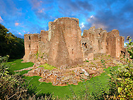 The 12th century medieval Norman ruins of Goodrich Castle fortifications, Goodrich, Herefordshire, England Goodrich Castle was probably built by Godric of Mappestone after the Norman invasion of England, initially as an earth and wooden fortification. In the middle of the 12th century the original Goodrich Castle was replaced with a stone keep, and was then expanded significantly during the late 13th century into a concentric structure combining luxurious living quarters with extensive defences. The success of Goodrich Castle's design influenced many other constructions across England over the following years.<br /> <br /> Visit our MEDIEVAL PHOTO COLLECTIONS for more   photos  to download or buy as prints https://funkystock.photoshelter.com/gallery-collection/Medieval-Middle-Ages-Historic-Places-Arcaeological-Sites-Pictures-Images-of/C0000B5ZA54_WD0s