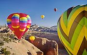 Hot air balloons soar near Church Rock during the Red Rock Balloon Rally, Gallup, New Mexico