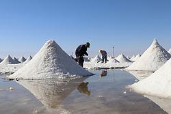 November 1, 2018 - Zhangye, Zhangye, China - Zhangye,CHINA-Workers at the Gaotai Salt Lake in Zhangye, northwest China's Gansu Province. The Gaotai Salt Lake, located in Gaotai County, is the oldest salt lake in Gansu Province. (Credit Image: © SIPA Asia via ZUMA Wire)
