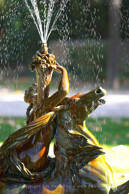 fountain and statue in the jardim do palacio de cristal park porto portugal