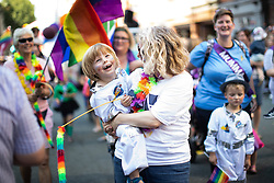 "© Licensed to London News Pictures . 24/08/2019. Manchester, UK. PARKER LINDLEY (four) and his mother RACHEL LINDLEY (44) of "" Proud to be Parents "" . The 2019 Manchester Gay Pride parade through the city centre , with a Space and Science Fiction theme . Manchester's Gay Pride festival , which is the largest of its type in Europe , celebrates LGBTQ+ life . Photo credit: Joel Goodman/LNP"