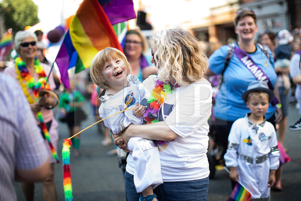 """© Licensed to London News Pictures . 24/08/2019. Manchester, UK. PARKER LINDLEY (four) and his mother RACHEL LINDLEY (44) of """" Proud to be Parents """" . The 2019 Manchester Gay Pride parade through the city centre , with a Space and Science Fiction theme . Manchester's Gay Pride festival , which is the largest of its type in Europe , celebrates LGBTQ+ life . Photo credit: Joel Goodman/LNP"""