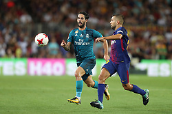 August 13, 2017 - Barcelona, Spain - Isco of Real Madrid duels for the ball with Jordi Alba of FC Barcelona during the Spanish Super Cup football match between FC Barcelona and Real Madrid on August 13, 2017 at Camp Nou stadium in Barcelona, Spain. (Credit Image: © Manuel Blondeau via ZUMA Wire)