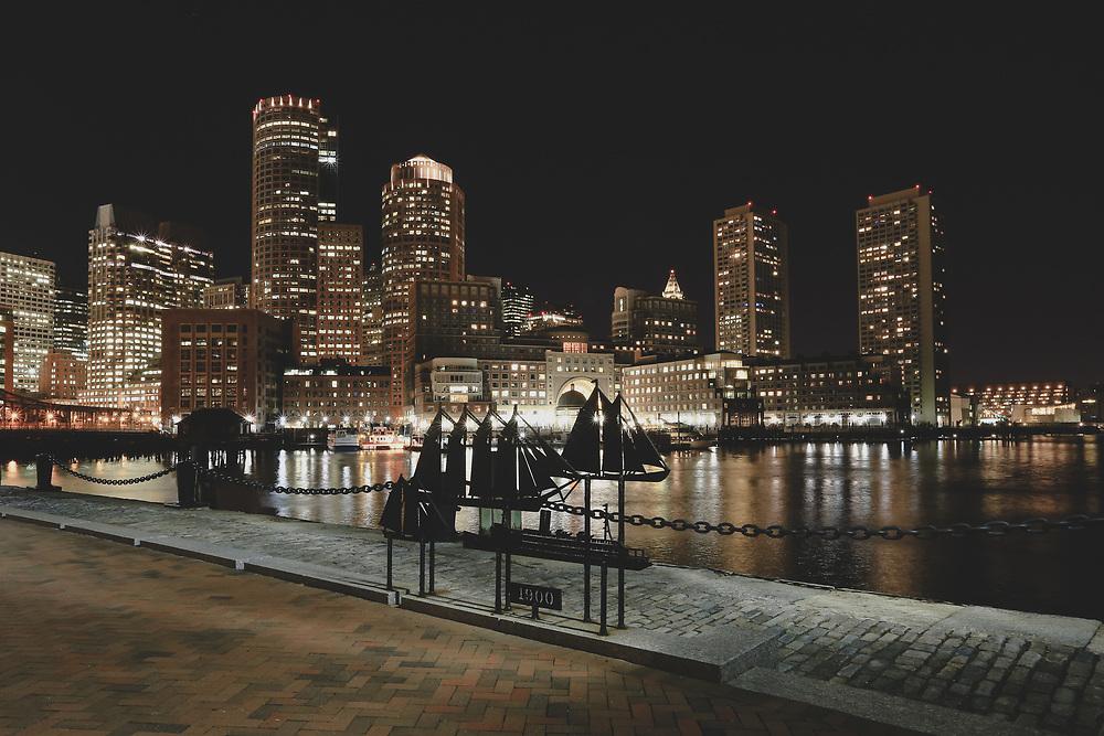 The Boston skyline seen at night from Fan Pier.
