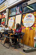 Black male sitting at table. Brixton is a district of south London, England, within the Borough of Lambeth. The area is identified in the London Plan as one of 35 major centres in Greater London. Brixton is mainly residential with a prominent street market and substantial retail sector. It is a multiethnic community, with a large percentage of its population of Afro-Caribbean descent. It lies within Inner London and is bordered by Stockwell, Clapham, Streatham, Camberwell, Tulse Hill, Balham and Herne Hill. The district houses the main offices of the London Borough of Lambeth. Brixton is 2.7 miles (4.3 km) south-southwest from the geographical centre of London near Brixton Underground station on the Victoria Line