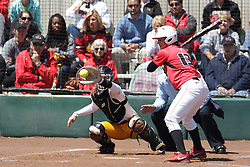 26 April 2015:   Batting for the Redbirds is Jordan de los Reyes (catching for the Ramblers is Annie Korth, home plate umpire is Steve McCrillis) during an NCAA Missouri Valley Conference (MVC) Championship series women's softball game between the Loyola Ramblers and the Illinois State Redbirds on Marian Kneer Field in Normal IL