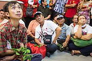 03 MARCH 2013 - BANGKOK, THAILAND: . Pheu Thai members and supporters of Pongsapat Pongchareon glumly watch as election results in the Bangkok governor's race come into the Pheu Thai headquarters. Pongsapat Pongchareon, running on the Pheu Thai ticket, lost the Bangkok's Governor's race to MR Sukhumbhand Paribatra, the incumbent running on the Democrat ticket. Sukhumbhand won the race after scoring a record number of votes, more than 1.2 million to Pongsapat's 1 million. The results were seen as an upset even though Sukhumbhand was the incumbent because all of the pre-election polls and the exit polls conducted on election day showed Patsapong winning.    PHOTO BY JACK KURTZ
