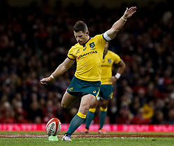 Bernard Foley of Australia kicks a penalty<br /> <br /> Photographer Simon King/Replay Images<br /> <br /> Under Armour Series - Wales v Australia - Saturday 10th November 2018 - Principality Stadium - Cardiff<br /> <br /> World Copyright © Replay Images . All rights reserved. info@replayimages.co.uk - http://replayimages.co.uk