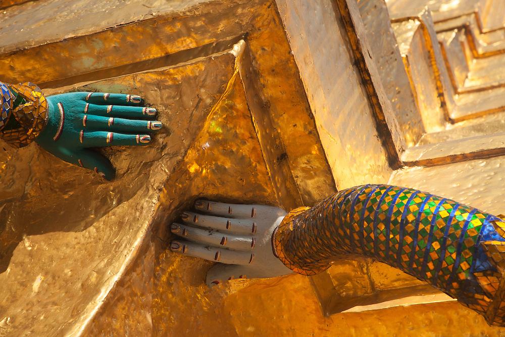 Asia, Thailand, Bangkok, mosaic hands on golden temple at Grand Palace