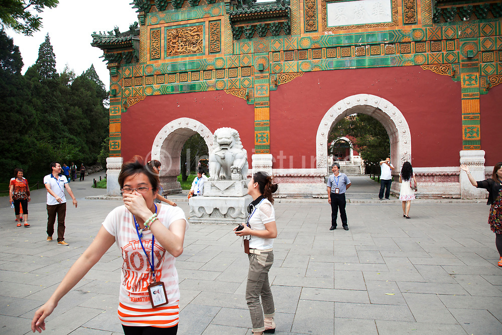Domestic Chinese tourists laugh at a joke between one another in Beihai Park. Beihai Park is an imperial garden in Beijing. First built in the 10th century, it is amongst the largest of Chinese gardens, and contains numerous historically important structures, palaces and temples. Since 1925, the place has been open to the public as a park. It is also connected at the south to the Shichahai. The Park has an area of more than 69 hectares, with a lake that covers more than half of the entire Park.