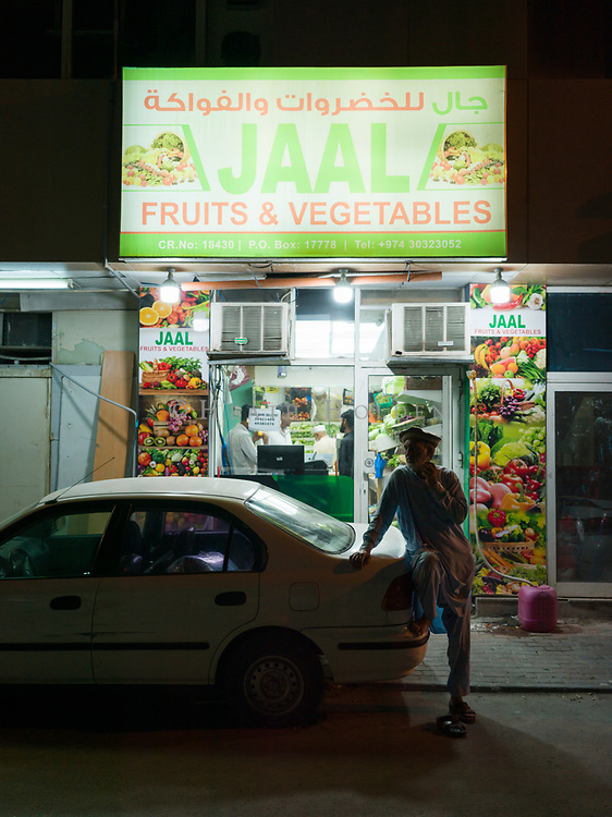 Atmospheric scenes of daily life from some of Doha's older neighbourhoods where the authentic Middle Eastern feel is still intact, for now. Habib Rahin waits outside a fruit andd vegetable shop in Al Jadeed.