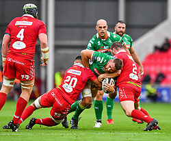 Marco Fuser of Benetton Treviso is tackled by Dan Davis of Scarlets<br /> <br /> Photographer Craig Thomas/Replay Images<br /> <br /> Guinness PRO14 Round 3 - Scarlets v Benetton Treviso - Saturday 15th September 2018 - Parc Y Scarlets - Llanelli<br /> <br /> World Copyright © Replay Images . All rights reserved. info@replayimages.co.uk - http://replayimages.co.uk