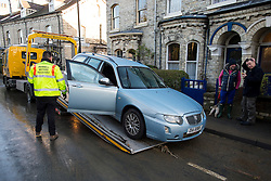 © Licensed to London News Pictures. 29/12/2015. York, UK. A car damaged in flooding being removed from Huntington Road in York city centre, where flood waters have dropped. Further rainfall is expected over coming days as Storm Frank approaches the east coast of the country. Photo credit: Ben Cawthra/LNP