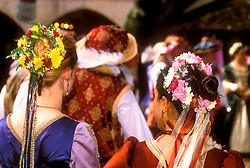 Stock photo of two young women with flowers in their hair at the Texas Renaissance Festival in Plantersville Texas