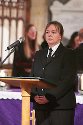 © Licensed to London News Pictures.  17/11/2013. THAME, UK. Family liaison officer PC Naomi Hames leads a prayer during the annual Road Deaths Memorial Service held in St Marys Church, Thame. 78 people were killed in traffic accidents in the Thames Valley Police area last year.  Photo credit: Cliff Hide/LNP