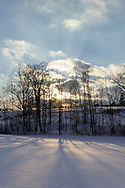 Sugar Loaf, New York - The sun sets behind a snowy field  on the afternoon of Feb. 14, 2014.