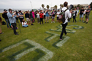 """Protesters gather around the """"Play it Safe"""" sign painted on the grass in St Kilda during the Sack Daniel Andrews Protest in St Kilda. Parts of the community are looking to hold the Victorian Premier accountable for the failings of his government that led to more than 800 deaths during the Coronavirus crisis. Victoria has recorded 36 days Covid free as pressure mounts on the Premier Daniel Andrews to relax all remaining restrictions. (Photo by Dave Hewison/Speed Media)"""