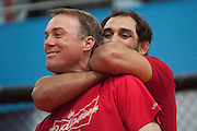 MMA fighter Johny Hendricks (right) shows NASCAR driver Kevin Harvick (left) how to put a person into a choke hold at Velociti Fitness League in Pantego on Wednesday, April 10, 2013. Hendricks spent the afternoon teaching Harvick a few basic MMA moves. (Cooper Neill/The Dallas Morning News)